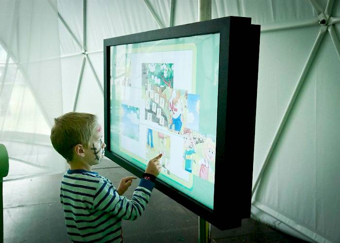 Touchscreen with interactive puzzle game