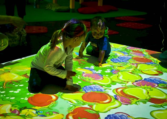 Children playing on interactive floor
