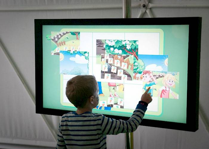 Touchscreen with puzzle game for kids